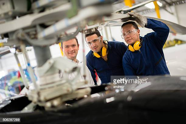 Mechanics working on a helicopter