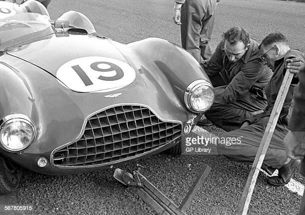 Mechanics working on an Aston Martin DB3S at the Dundrod TT Northern Ireland 1953