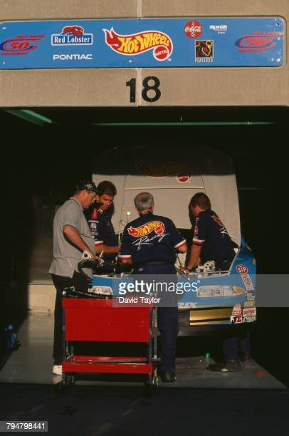 Mechanics working on the Petty Enterprises number 43 Pontiac Grand Prix at the Brickyard 400 at Indianapolis Motor Speedway in Speedway Indiana 6th...