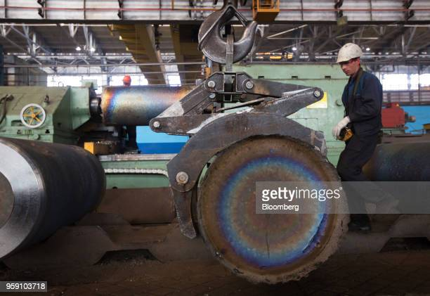 A mechanised machine arm moves an ingot of titanium alloy after melting in a vacuum arc furnace at the VSMPOAVISMA Corp plant in Verkhnyaya Salda...
