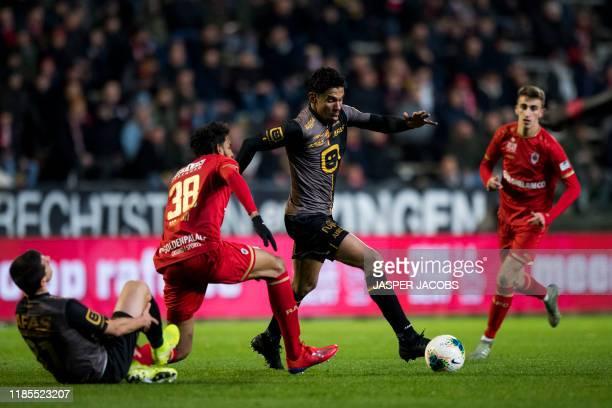 Mechelen's Dante Vanzeir, Antwerp's Faris Haroun and Mechelen's Igor de Camargo fight for the ball during a soccer match between Royal Antwerp FC and...