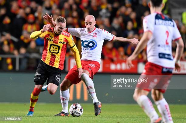 Mechelen's Gustav Engvall and Kortrijk's Christophe Lepoint fight for the ball during a soccer match between KV Mechelen and KV Kortrijk, Saturday 07...