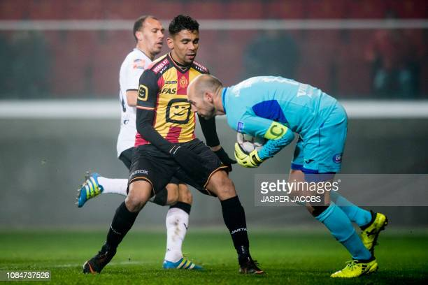 Mechelen's Igor de Camargo and Roeselare's goalkeeper Wouter Biebauw fight for the ball during a soccer game between KV Mechelen and Roeselare Friday...