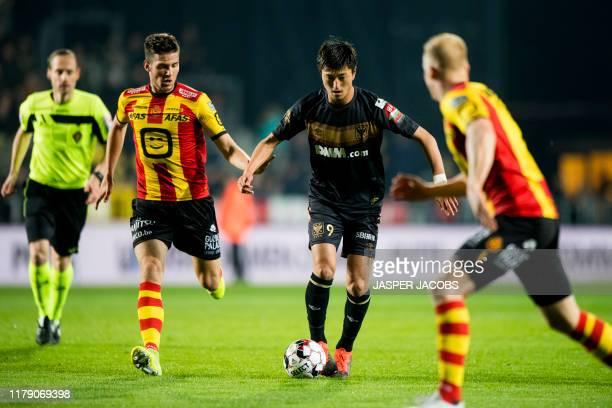 Mechelen's Jordi Vanlerberghe and STVV's Yuma Suzuki fight for the ball during a soccer match between KV Mechelen and STVV Sint-Truiden, Wednesday 30...