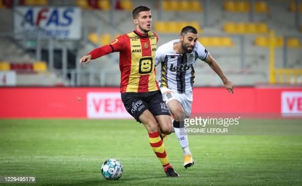 Mechelen's Jordy Vanlerberghe and Charleroi's Kaveh Rezaei fight for the ball during a soccer match between KV Mechelen and Sporting Charleroi,...