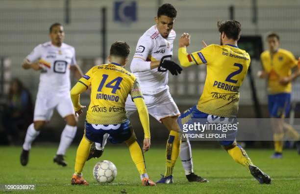 Mechelen's Maxime De Bie and Mechelen's Igor de Camargo fight for the ball during a soccer game between Royale Union Saint Gilloise and KV Mechelen...