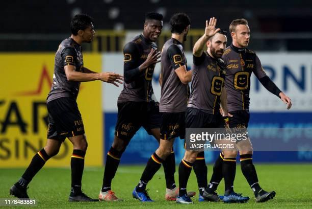 Mechelen's players and Mechelen's Onur Kaya celebrate after scoring during a soccer match between Waasland-Beveren and KV Mechelen, Sunday 27 October...