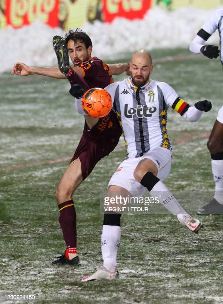 Mechelen's Thibaut Peyre and Charleroi's Dorian Dessoleil fight for the ball during a soccer match between Sporting Charleroi and KV Mechelen,...
