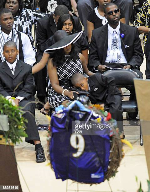 Mechelle McNair center and family members attend a funeral service for former NFL quarterback Steve McNair on July 11 2009 in Hattiesburg Mississippi