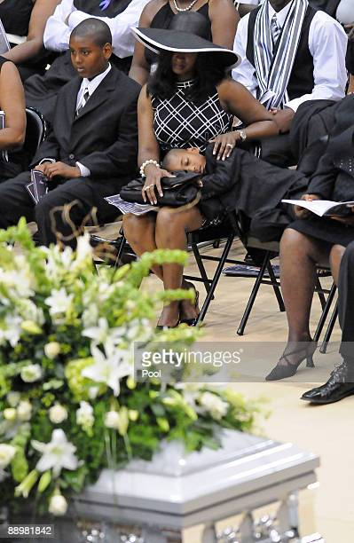Mechelle McNair center and her children attend a funeral service for former NFL quarterback Steve McNair on July 11 2009 in Hattiesburg Mississippi
