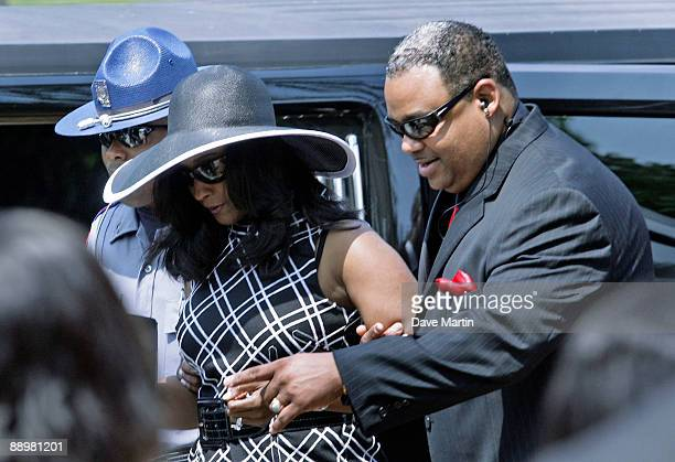 Mechelle McNair wife of slain quarterback Steve McNair is escorted into a funeral service for former NFL quarterback Steve McNair on July 11 2009 in...