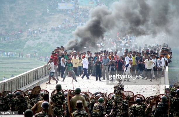 Bhutanese Refugees hurl stones at Indian security forces trying to prevent them from crossing the border into India from crossing into India Mechi...