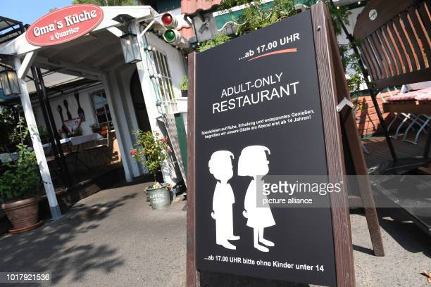 A sign with the inscription 'AdultOnly Restaurant from 1700 please without children under 14' is in front of the entrance of the restaurant...