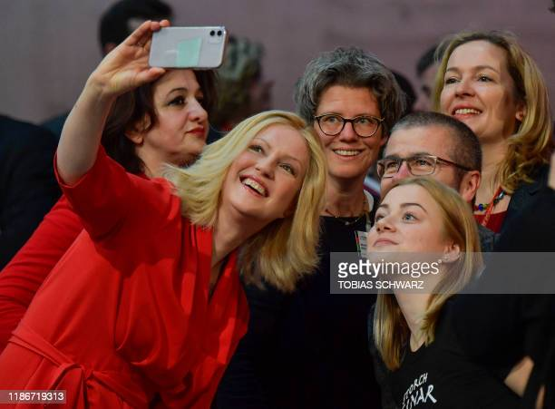 Mecklenburg-Western Pomerania's State Premier SPD Manuela Schwesig makes a selfie with delegates before the start of the party congress of Germany's...