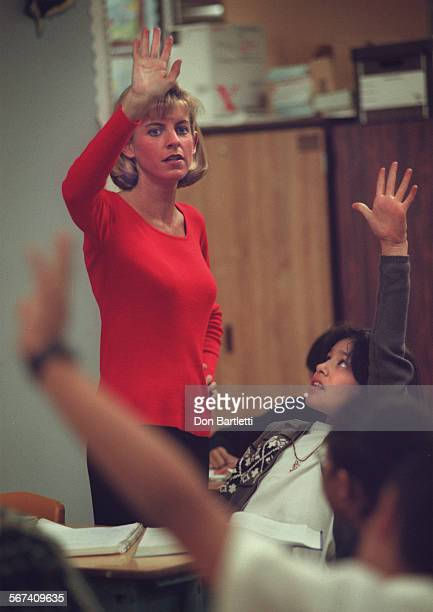 MEClassHandsDB010798––SantaAna–– Hands go up as Fremont Elementary School teacher Lisa Haydt calls for answers from her fifth–grade students She...