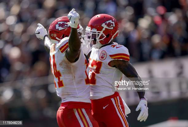 Mecole Hardman and Sammy Watkins of the Kansas City Chiefs celebrates after Hardman caught a touchdown pass against the Oakland Raiders during the...