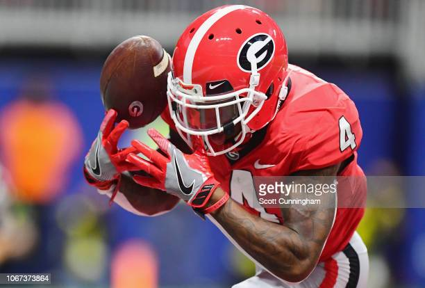 Mecole Hardman of the Georgia Bulldogs attempts to make a reception in the first half against the Alabama Crimson Tide during the 2018 SEC...
