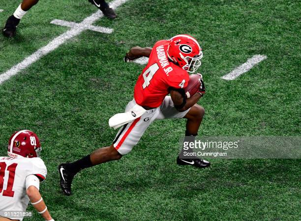 Mecole Hardman of the Georgia Bulldogs carries the ball against the Alabama Crimson Tide in the CFP National Championship presented by ATT at...