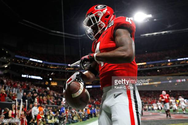 Mecole Hardman of the Georgia Bulldogs celebrates a touchdown during the second quarter against the Alabama Crimson Tide in the CFP National...