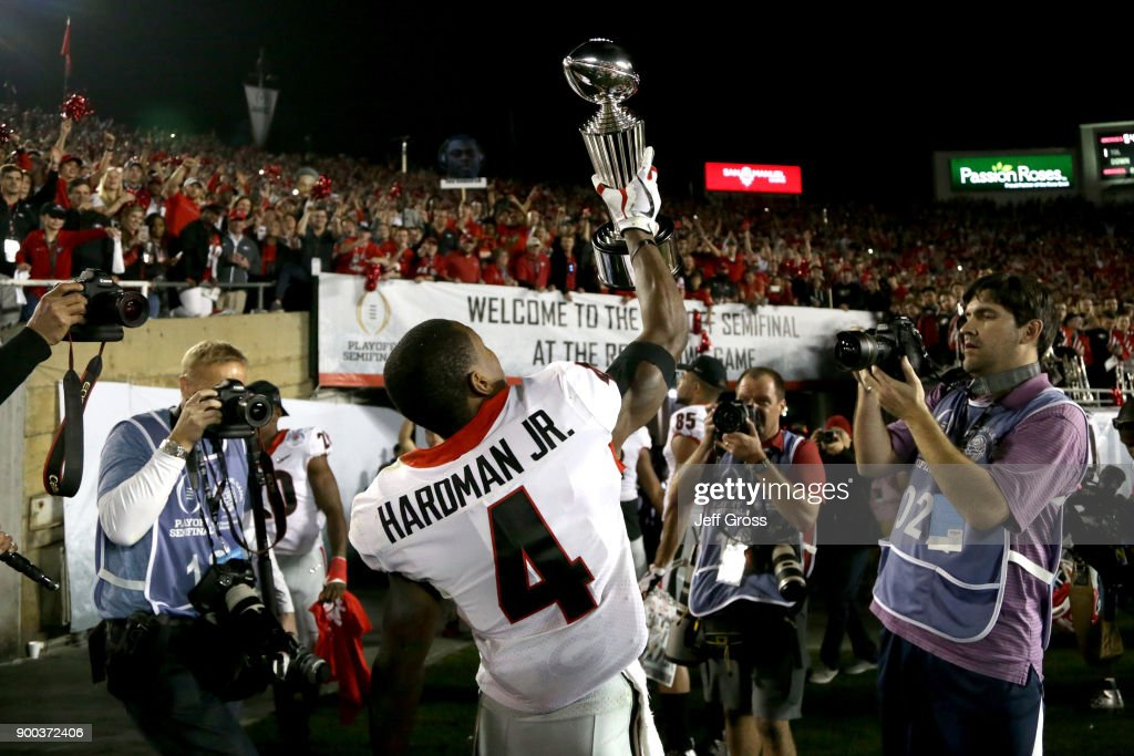 Mecole Hardman #4 of the Georgia Bulldogs celebrates by holding up the trophy after the Georgia Bulldogs beat the Oklahoma Sooners in the 2018 College Football Playoff Semifinal at the Rose Bowl Game presented by Northwestern Mutual at the Rose Bowl on January 1, 2018 in Pasadena, California.