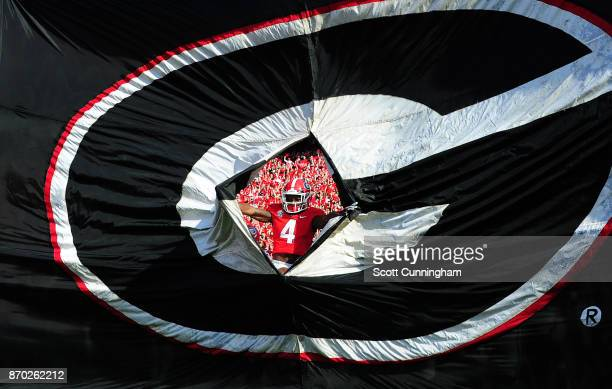 Mecole Hardman of the Georgia Bulldogs is the first to take the field against the South Carolina Gamecocks at Sanford Stadium on November 4 2017 in...