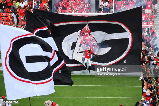 Mecole Hardman of the Georgia Bulldogs leads his team on to the field before the game against the Middle Tennessee Blue Raiders on September 15 2018...