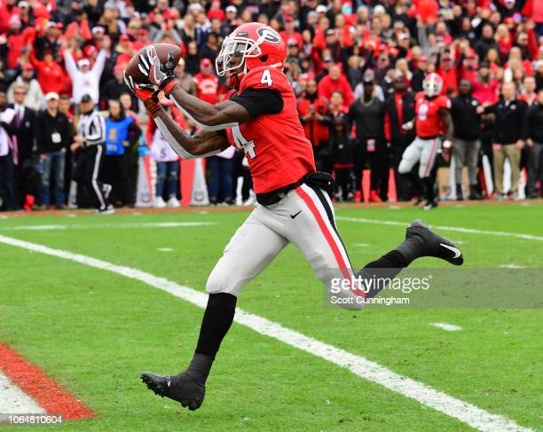 Mecole Hardman of the Georgia Bulldogs makes a catch for a second quarter touchdown against the Georgia Tech Yellow Jackets on November 24 2018 at...