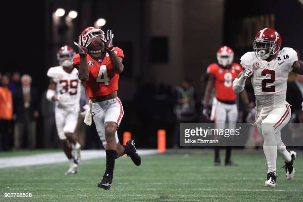 Mecole Hardman of the Georgia Bulldogs makes a catch for an 80 yard touchdown during the third quarter against the Georgia Bulldogs in the CFP...