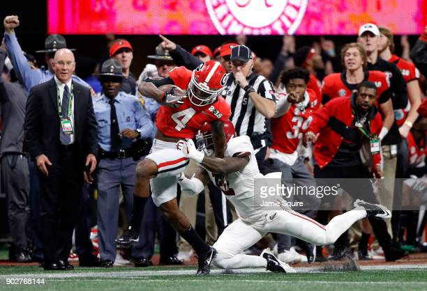 Mecole Hardman of the Georgia Bulldogs manages stays in bounds for an 80 yard touchdown reception against Tony Brown of the Alabama Crimson Tide...