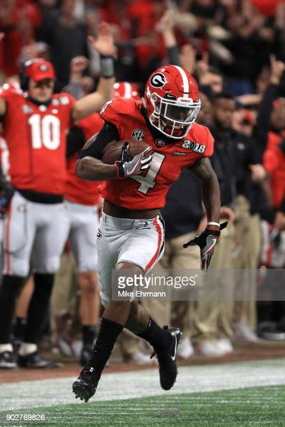 Mecole Hardman of the Georgia Bulldogs manages to stay in bounds for an 80 yard touchdown reception against Tony Brown of the Alabama Crimson Tide...