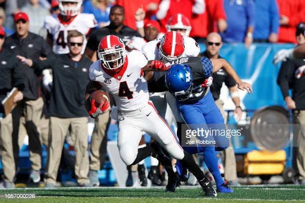 Mecole Hardman of the Georgia Bulldogs returns a punt 65 yards to set up a touchdown in the first quarter of the game against the Kentucky Wildcats...