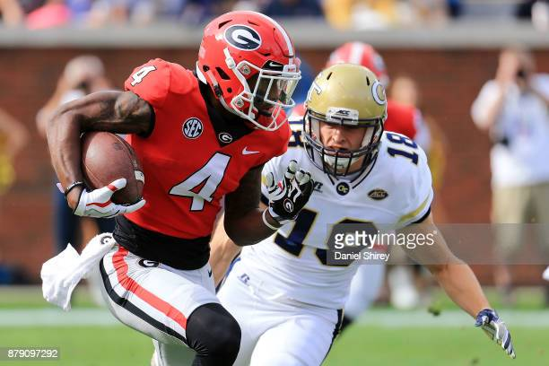 Mecole Hardman of the Georgia Bulldogs returns a punt during the first half against the Georgia Tech Yellow Jackets at Bobby Dodd Stadium on November...