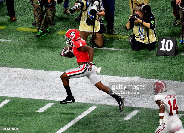 Mecole Hardman of the Georgia Bulldogs runs with a catch for a touchdown against the Alabama Crimson Tide in the CFP National Championship presented...