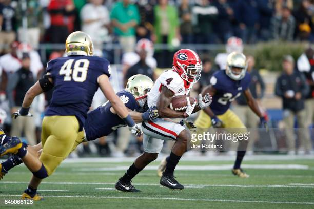 Mecole Hardman of the Georgia Bulldogs runs with the ball after a reception against the Notre Dame Fighting Irish in the first quarter of a game at...