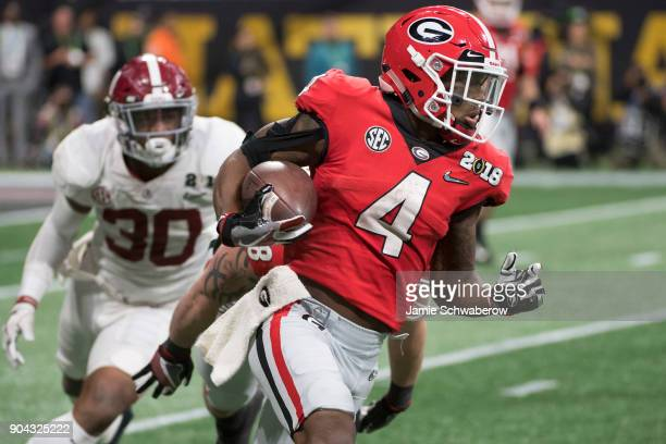 Mecole Hardman of the Georgia Bulldogs rushes against the Alabama Crimson Tide during the College Football Playoff National Championship held at...