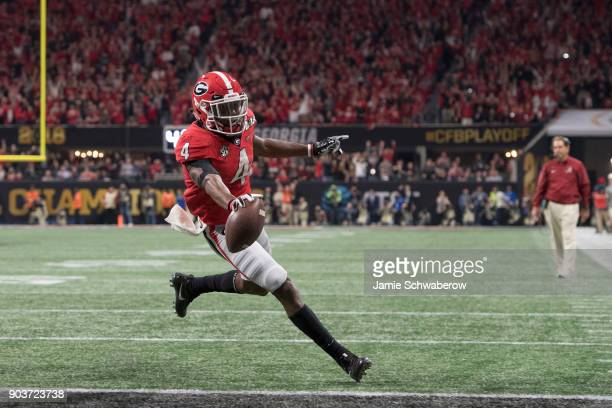 Mecole Hardman of the Georgia Bulldogs scores a touchdown against the Alabama Crimson Tide during the College Football Playoff National Championship...