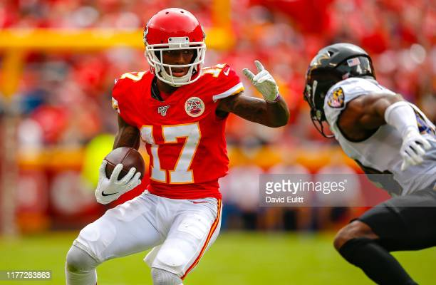 Mecole Hardman of the Kansas City Chiefs avoids the tackle attempt of Marlon Humphrey of the Baltimore Ravens at Arrowhead Stadium on September 22...