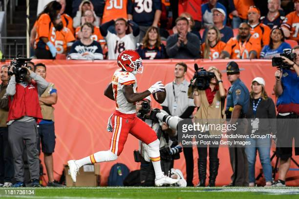 Mecole Hardman of the Kansas City Chiefs beats Kareem Jackson of the Denver Broncos for a touchdown reception during the first quarter on Thursday,...
