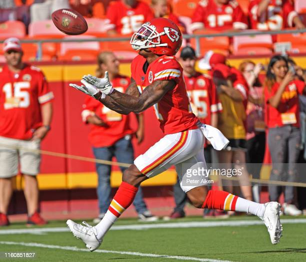 Mecole Hardman of the Kansas City Chiefs catches a punt during pregame warm ups before a preseason game against the Cincinnati Bengals at Arrowhead...