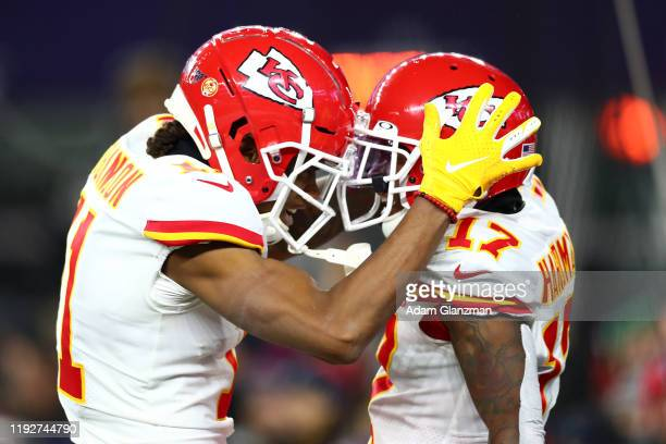 Mecole Hardman of the Kansas City Chiefs celebrates with Demarcus Robinson after scoring a 48yard receiving touchdown during the second quarter...