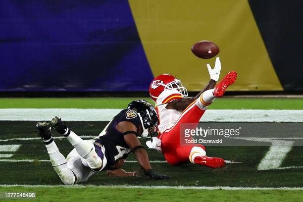 Mecole Hardman of the Kansas City Chiefs fails to catch a touchdown pass against Marlon Humphrey of the Baltimore Ravens during the second quarter at...