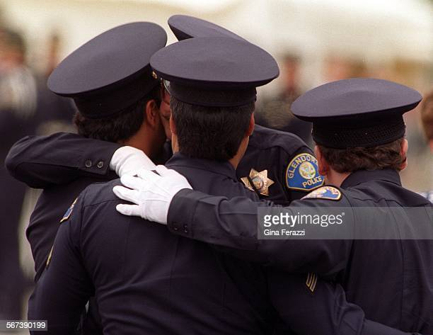 CopFuneral#4.0615.GFOfficers from the Glendora police department embrace after Memorial Services for slain Glendora Agent Louis Pompei at the Crystal...