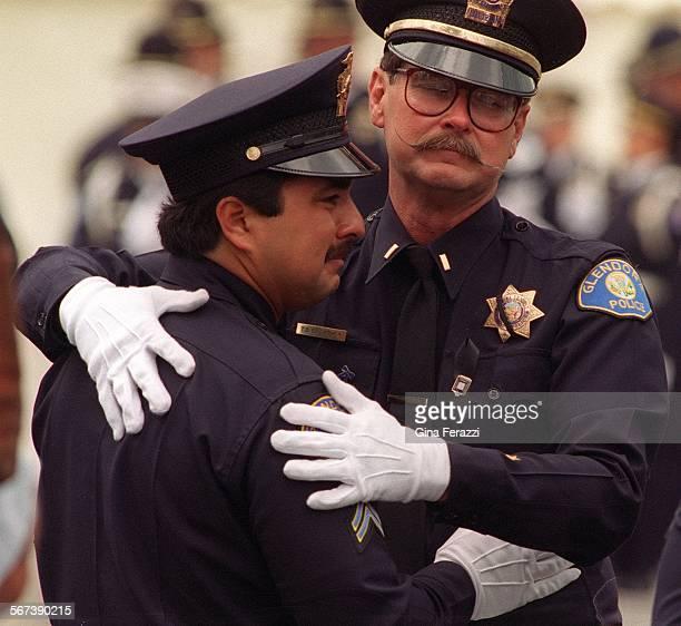 CopFuneral#5.0615.GFGlendora police officers Marty Amaro,left, and Lt. Tim Crowther,right, embrace after Memorial Services for slain Glendora Agent...