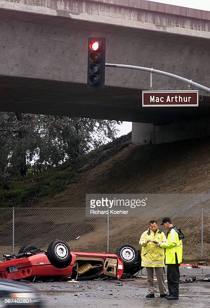 MECorvetteCHP officer and Irvine police officer investigates accident scene Wednesday approx 727 am 2/26/03 on MacArthur Blvd at Fairchild Road...
