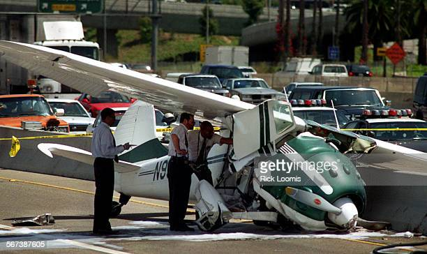 MEcrashinvestigate0811RL–Irvine–Investigators looks at the wreckage of a plane that crashed near the 405 freeway landing near the north bound...