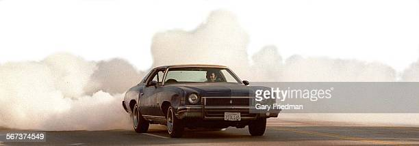 MECrenshaw#4GF A 1973 Monte Carlo driven by Steve Allen does a spin and burning rubber on Crenshaw Blvd on a recent Sunday evening
