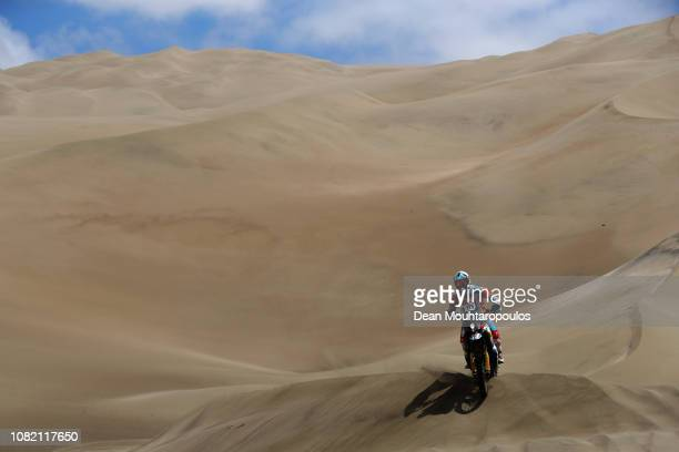 Med Team No 115 Motorbike ridden by Juan Puga of Ecuador competes in the desert on the sand during Stage Six of the 2019 Dakar Rally between Arequipa...