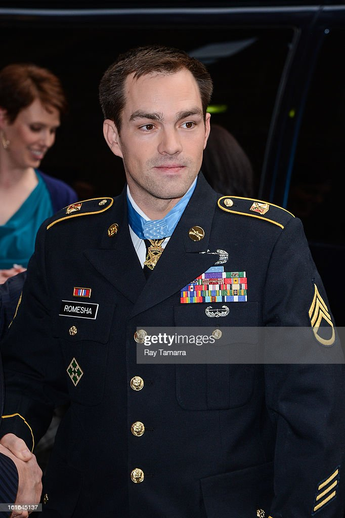 Medal of Honor recipient Staff Sgt. Clinton Romesha enters the 'Late Show With David Letterman' taping at the Ed Sullivan Theater on February 13, 2013 in New York City.