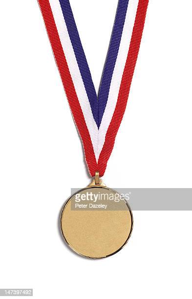 a medal on a striped ribbon, on a white background - gouden medaille stockfoto's en -beelden