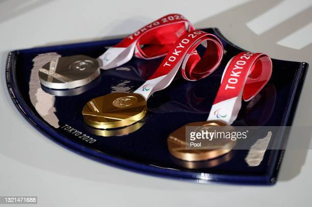 Medal tray that will be used during the victory ceremonies at the Tokyo 2020 Olympic Games is displayed during an unveiling event for the victory...